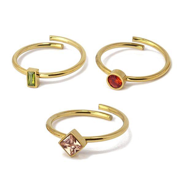 Triple anillo ajustable con cristales. Acero. Rosa-olivino-granate