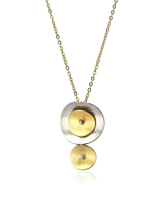 Gargantilla de acero con círculos concavos. Oro-plata