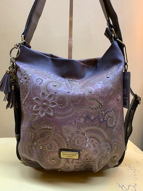Bolso y mochila con bordado tachuelas y print