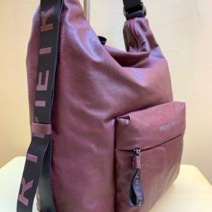 Bolso y mochila de Robert Pietri en lona plastificada. Granate