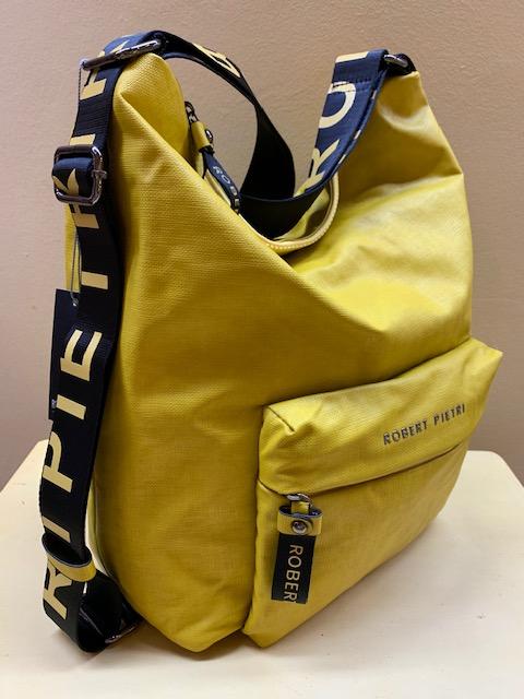Bolso mochila tejido plastificado Robert Pietri. Vista lateral, mostaza