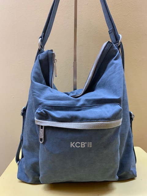 Bolso y mochila tejido denim plastificado de Kcb. Azul