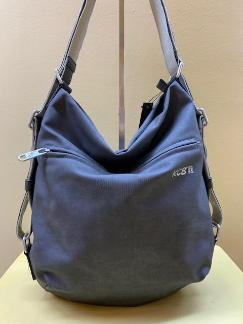 Bolso y mochila tipo saco plastificado de Kcb. Negro