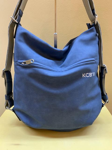 Bolso y mochila tipo saco plastificado de Kcb. Azul