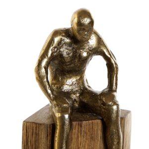 Escultura hombre pensando aluminio dorado y madera de mango. Vista parcial