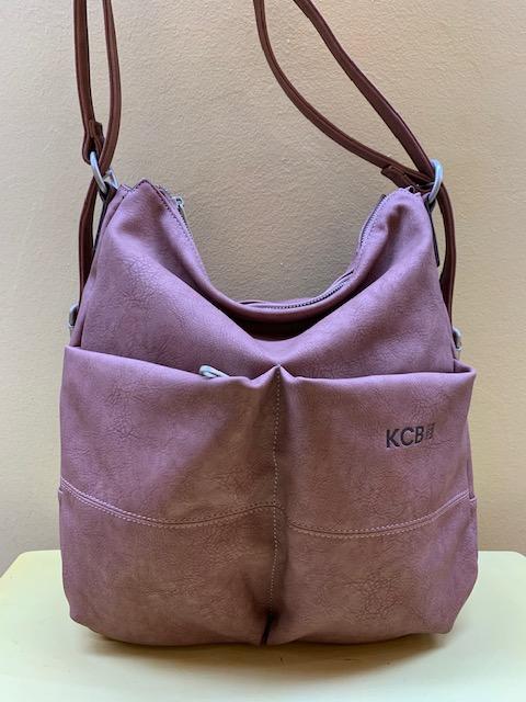 Bolso y mochila multibolsillos en piel sintética mate de Kcb. Frontal rosa